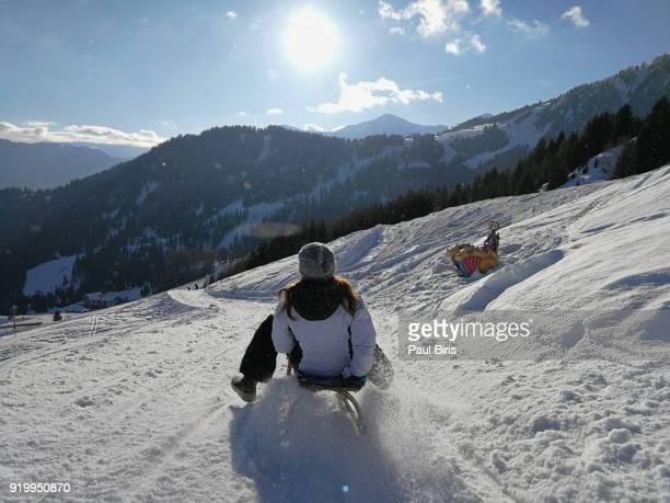 tobogganing in tyrol, serfaus fiss ladis ski area in austria - tobogganing stock pictures, royalty-free photos & images