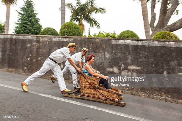 toboggans or wicker sledges, madeira, portugal - funchal stock pictures, royalty-free photos & images