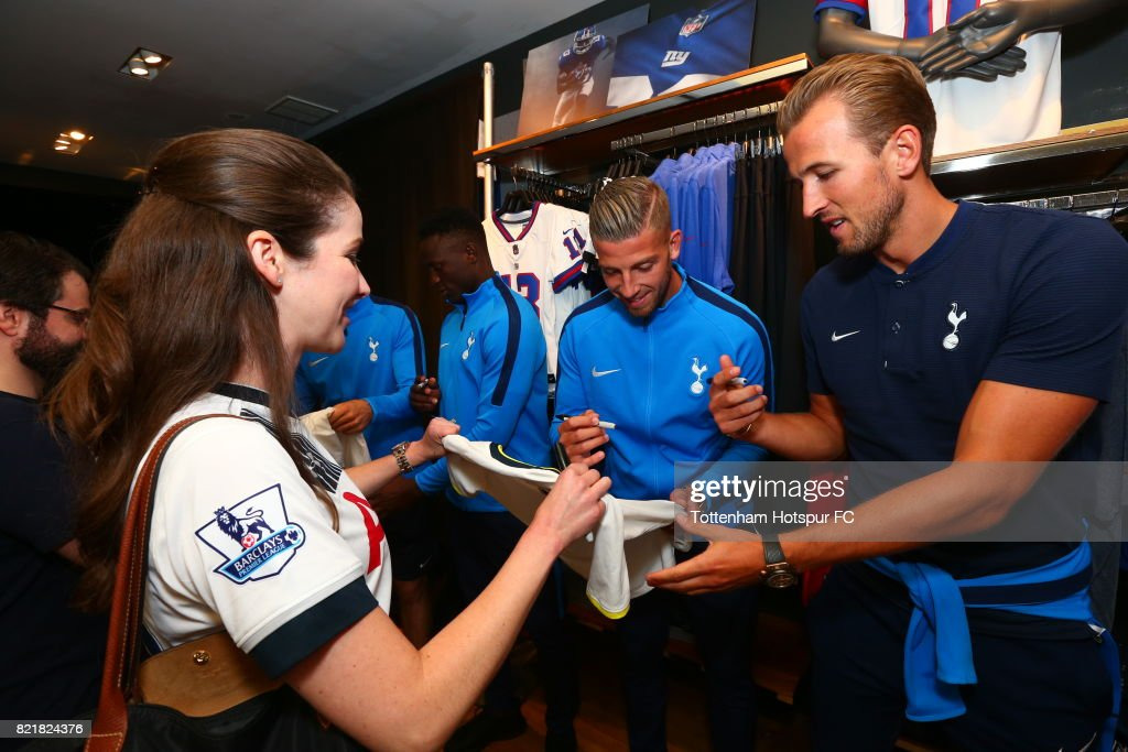 Toby Alderweireld and Harry Kane of Tottenham Hotspur FC signs a ball for a fan on a visit to Nike Town on Tottenham Hotspur Pre-Season Tour to the US on July 23, 2017 in New York, New York.