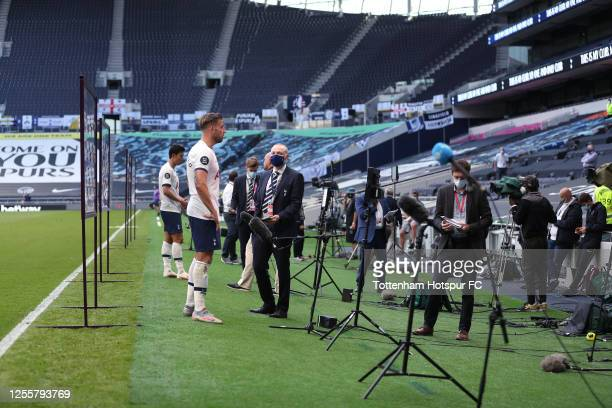 Toby Alderweireld and Heung-Min Son of Tottenham Hotspur are interviewed after the Premier League match between Tottenham Hotspur and Arsenal FC at...