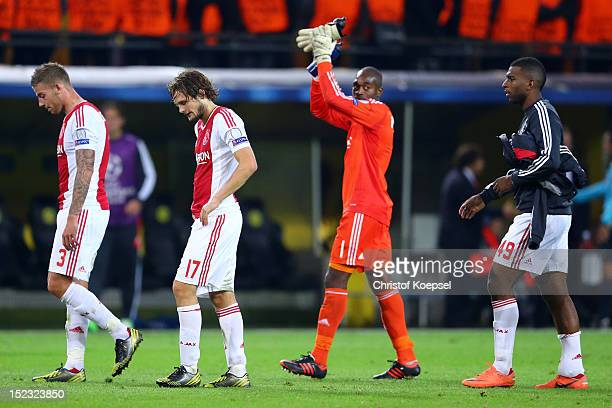 Toby Alderweireld Daley Blind Kenneth Vermeer and Ryan Babel of Amsterdam look dejected after losing 01 the UEFA Champions League group D match...