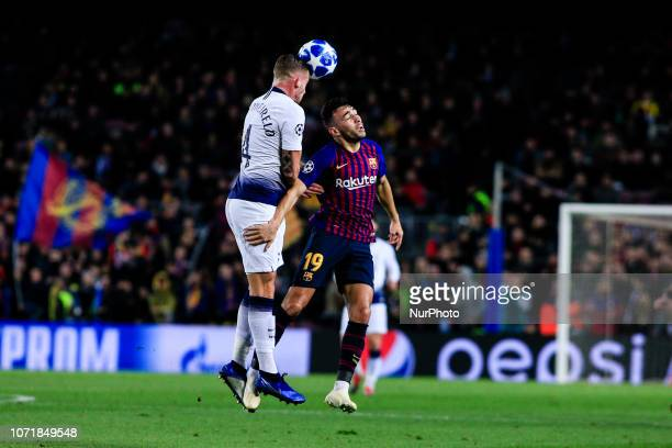 04 Toby Alderweireld from Belgium of Tottenham Hotspur and 19 Munir of FC Barcelona during the UEFA Champions League Group B match between FC...