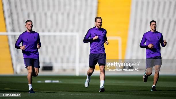 Toby Alderweireld, Harry Kane and Erik Lamela of Tottenham Hotspur run during a training session on March 11, 2019 at Estadi Olimpic Lluis Companys...