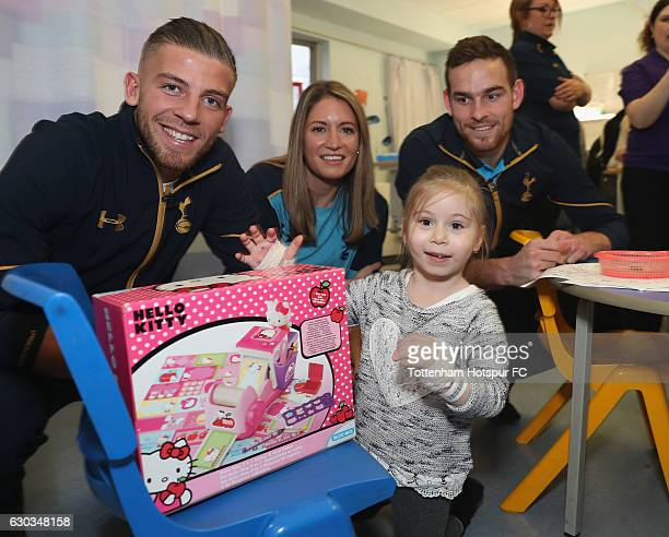 Toby Alderweireld Jenna Schillaci and Vincent Janssen of Tottenham Hotspur pose for the camera with a young patient as they visit Whittington...