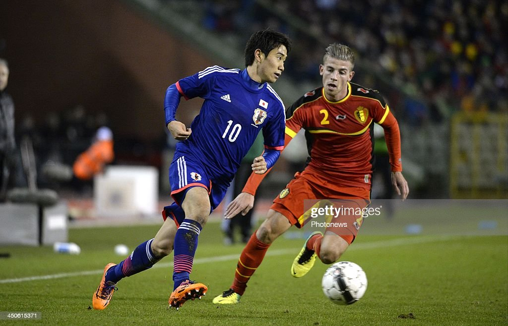Toby Alderweireld of Belgium and Kagawa of Japan pictured during the international friendly match before the World Cup in Brasil between Belgium and Japan on November 19, 2013 in Brussels, Belgium