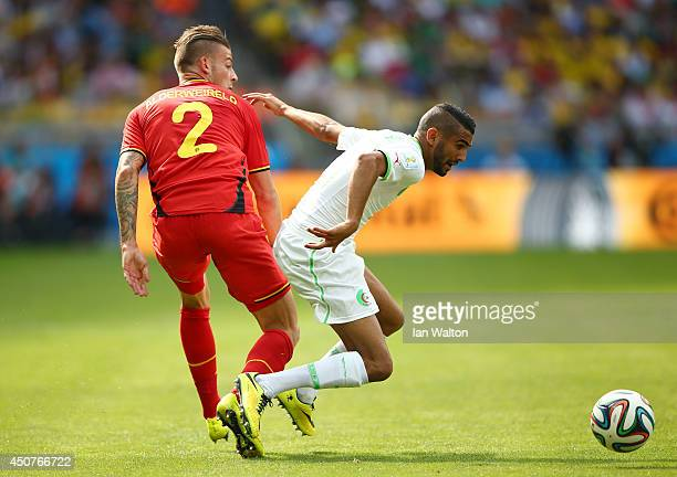 Toby Alderweireld of Belgium and Riyad Mahrez of Algeria battle for the ball during the 2014 FIFA World Cup Brazil Group H match between Belgium and...