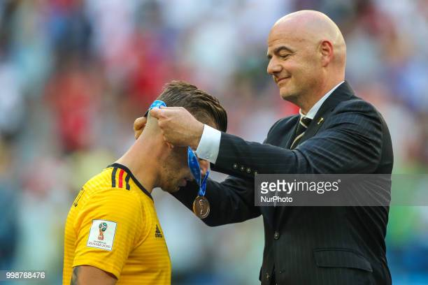 Toby Alderweireld of Belgium receives his medal from FIFA President Gianni Infantino after the 2018 FIFA World Cup Russia 3rd Place Playoff match...