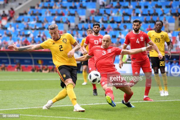 Toby Alderweireld of Belgium shoots at goal as Yohan Ben Alouane of Tunisia attempts to block during the 2018 FIFA World Cup Russia group G match...
