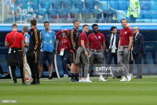 Toby Alderweireld of Belgium speaks with Tottenham Hotspur teammates Kieran Trippier Danny Rose and Harry Kane of England during a pitch inspection...