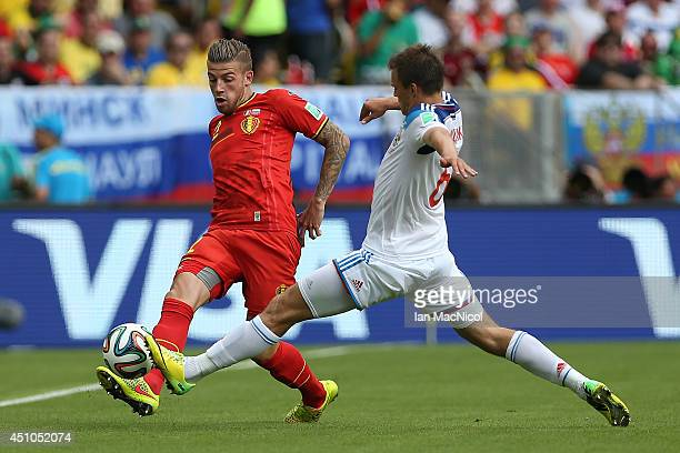 Toby Alderweireld of Belgium vies with Andrey Semyonov of Russia during the Group H match of the 2014 World Cup between Belgium and Russia at The...