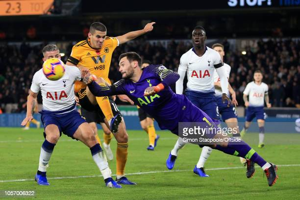 Toby Alderweireld of Spurs holds off Conor Coady of Wolves as Spurs goalkeeper Hugo Lloris punches clear during the Premier League match between...