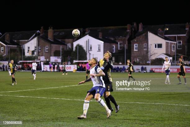 Toby Alderweireld of Tottenham Hotspur and James Barrigan of Marine compete for a header during the FA Cup Third Round match between Marine and...