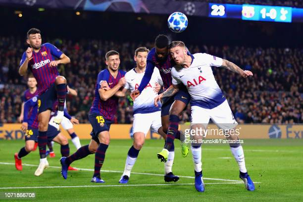 Toby Alderweireld of Tottenham Hotspur and Nelson Semedo of FC Barcelona jump for a header during the UEFA Champions League Group B match between FC...