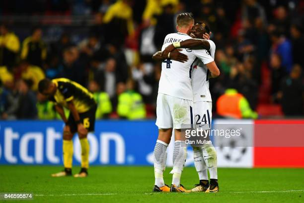 Toby Alderweireld of Tottenham Hotspur and Serge Aurier of Tottenham Hotspur celebrates victory together after the UEFA Champions League group H...