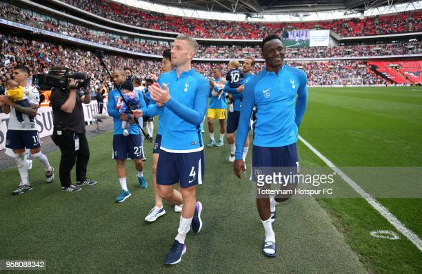 Toby Alderweireld of Tottenham Hotspur and Victor Wanyama of Tottenham Hotspur enjoys the lap of honour after the Premier League match between...