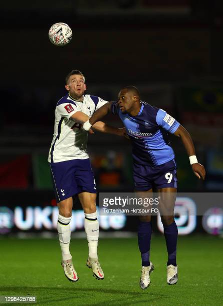 Toby Alderweireld of Tottenham Hotspur battles for possession with Uche Ikpeazu of Wycombe Wanderers during The Emirates FA Cup Fourth Round match...