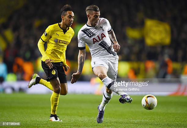 Toby Alderweireld of Tottenham Hotspur beats PierreEmerick Aubameyang of Borussia Dortmund to the ball during the UEFA Europa League round of 16...