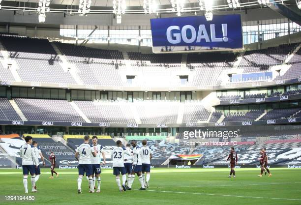 Toby Alderweireld of Tottenham Hotspur celebrates after scoring their third goal with Ben Davies during the Premier League match between Tottenham...