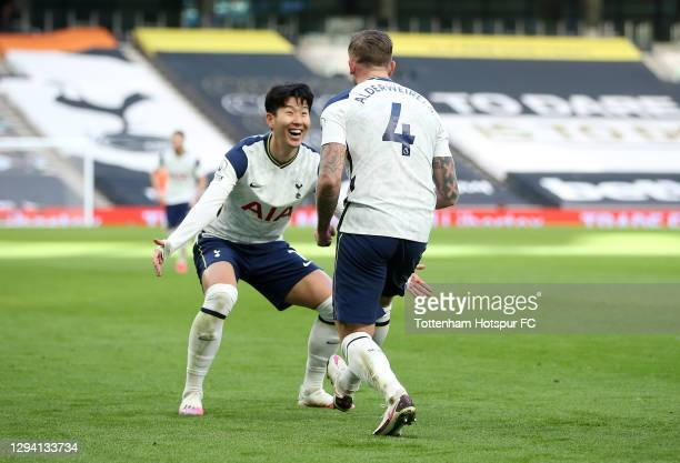 Toby Alderweireld of Tottenham Hotspur celebrates with teammate Son Heung-Min of after scoring their team's third goal during the Premier League...