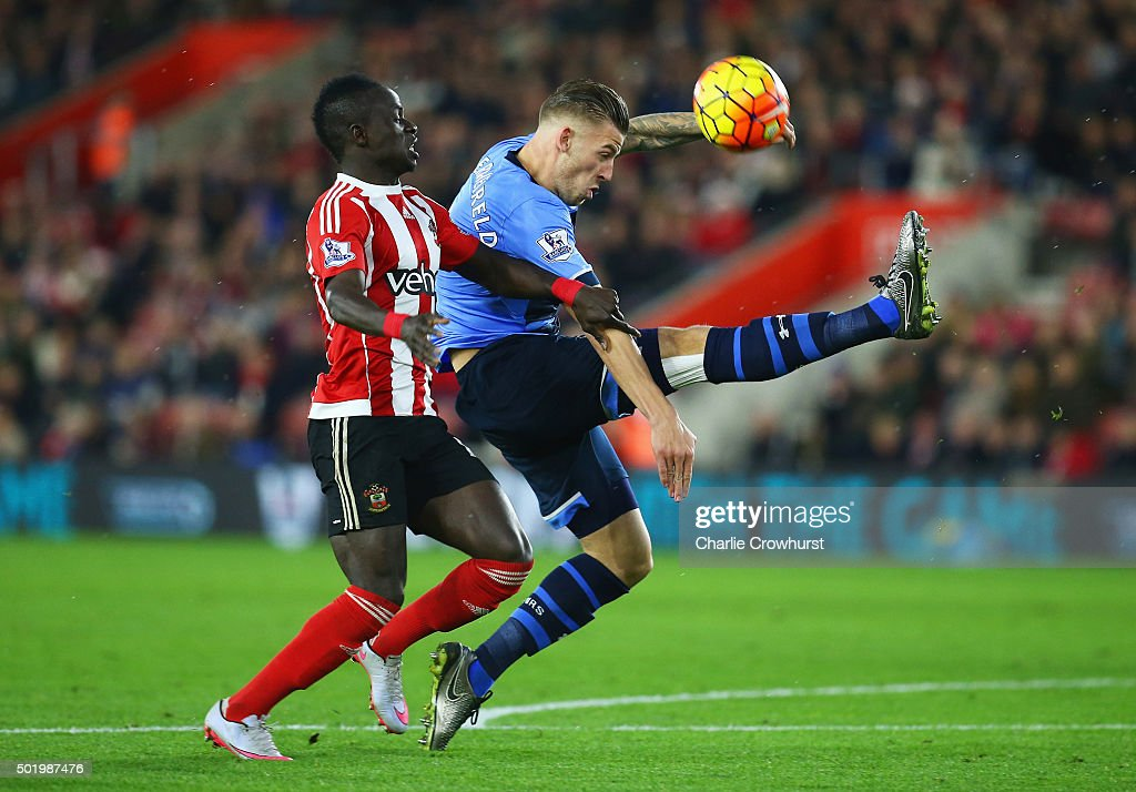 Toby Alderweireld of Tottenham Hotspur clears the ball from Sadio Mane of Southampton during the Barclays Premier League match between Southampton and Tottenham Hotspur at St Mary's Stadium on December 19, 2015 in Southampton, England.