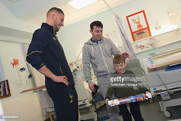 Toby Alderweireld of Tottenham Hotspur delivers a present to a young patient at Whittington Hospital as Tottenham Hotspur Players Deliver Christmas...