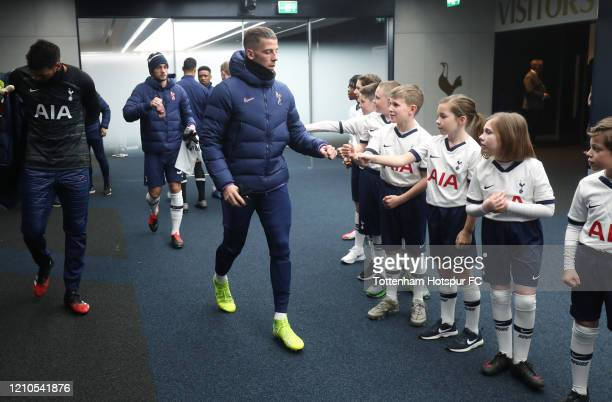 Toby Alderweireld of Tottenham Hotspur greets the mascots prior to the FA Cup Fifth Round match between Tottenham Hotspur and Norwich City at...