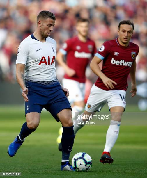 Toby Alderweireld of Tottenham Hotspur is challenged by Mark Noble of West Ham United during the Premier League match between West Ham United and...