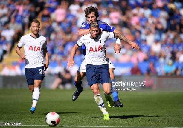 Toby Alderweireld of Tottenham Hotspur is held back by Caglar Soyuncu of Leicester City during the Premier League match between Leicester City and...