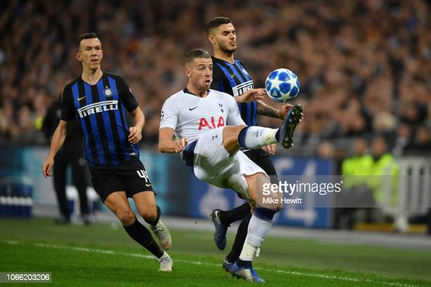 Toby Alderweireld of Tottenham Hotspur looks on with Ivan Perisic of Inter Milan during the UEFA Champions League Group B match between Tottenham...