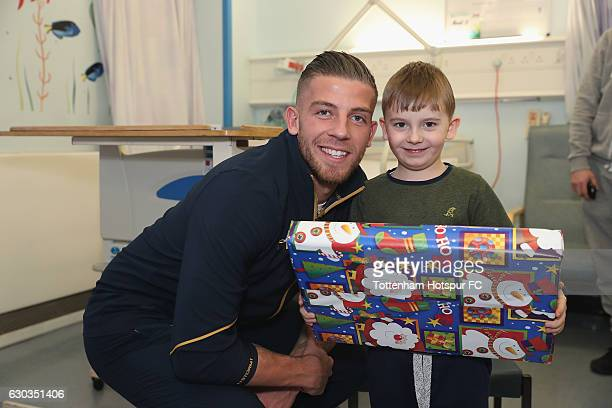 Toby Alderweireld of Tottenham Hotspur poses with a young patient as he delivers a present at Whittington Hospital as Tottenham Hotspur Players...