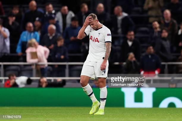 Toby Alderweireld of Tottenham Hotspur reacts after FC Bayern Munich's seventh goal during the UEFA Champions League group B match between Tottenham...