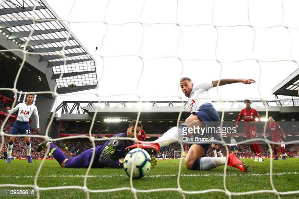 Toby Alderweireld of Tottenham Hotspur scores an own goal as Hugo Lloris attempts to save during the Premier League match between Liverpool FC and...