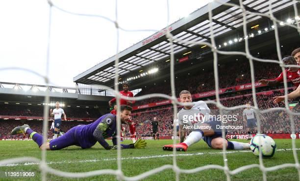 Toby Alderweireld of Tottenham Hotspur scores an own goal past Hugo Lloris during the Premier League match between Liverpool FC and Tottenham Hotspur...