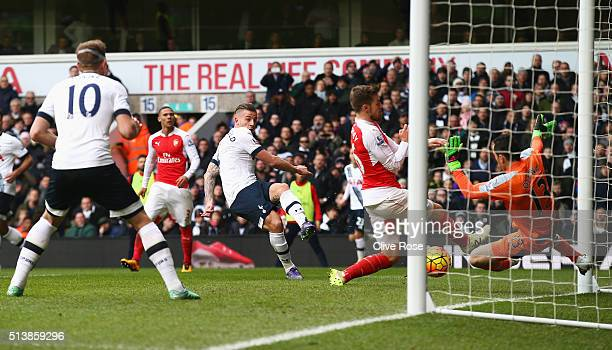 Toby Alderweireld of Tottenham Hotspur scores his team's first goal during the Barclays Premier League match between Tottenham Hotspur and Arsenal at...