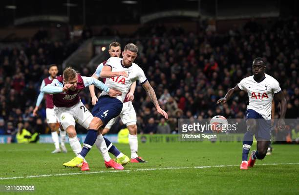 Toby Alderweireld of Tottenham Hotspur shoots under pressure from Matej Vydra of Burnley during the Premier League match between Burnley FC and...