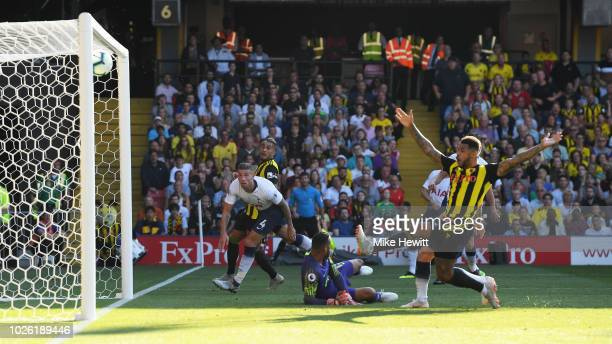 Toby Alderweireld of Tottenham Hotspur watches as he deflects a cross onto the post during the Premier League match between Watford FC and Tottenham...
