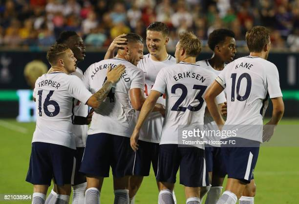 Toby Alderweireld of Tottenham Hotspurs celebrates with his teammates after scoring a goal in the second half against Paris SaintGermain during a...