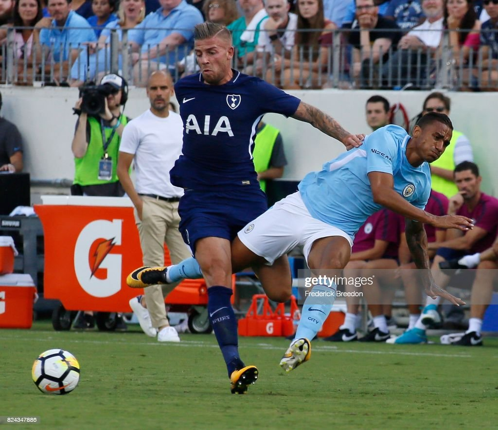 Toby Alderweireld #4 of Tottenham knocks Danilo #3 of Manchester City to the ground during the first half of the 2017 International Champions Cup Presented by Heineken at Nissan Stadium on July 29, 2017 in Nashville, Tennessee.