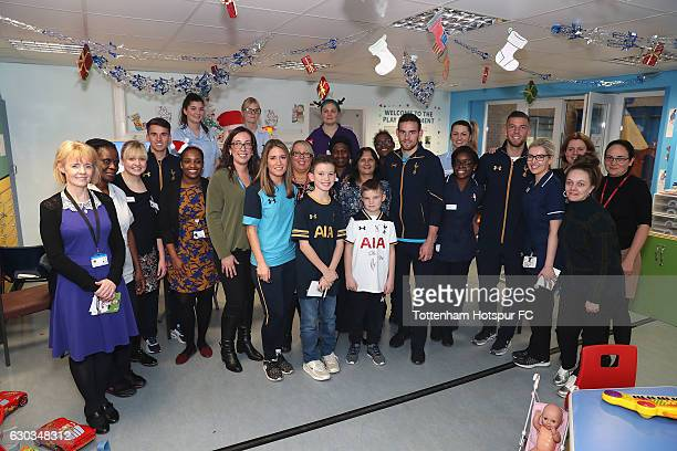 Toby Alderweireld Vincent Janssen Tom Carroll and Jenna Schillaci of Tottenham Hotspur pose for the camera with staff and nurses as they visit...