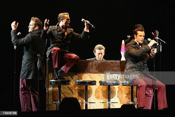Toby Allen, Michael Tierney, Andrew Tierney and Phil Burton of Human Nature perform on stage in concert on the first Melbourne night of their...