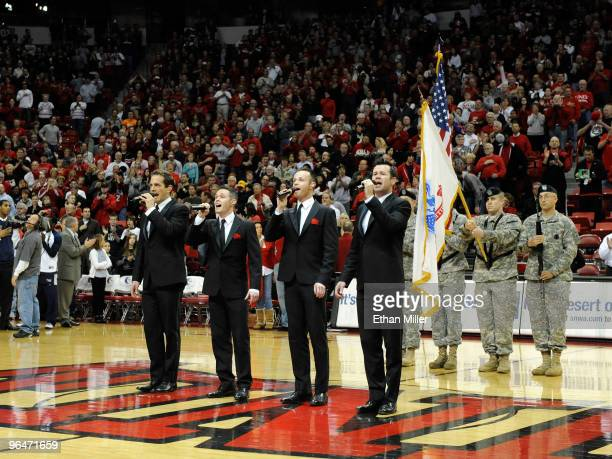 Toby Allen Michael Tierney Andrew Tierney and Phil Burton of the Australian vocal group Human Nature sing the American national anthem before a game...
