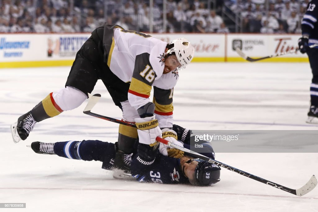 Toby Enstrom #39 of the Winnipeg Jets is knocked down to the ice by James Neal #18 of the Vegas Golden Knights during the second period in Game One of the Western Conference Finals during the 2018 NHL Stanley Cup Playoffs at Bell MTS Place on May 12, 2018 in Winnipeg, Canada.
