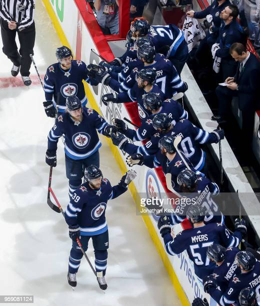 Toby Enstrom Patrik Laine and Nikolaj Ehlers of the Winnipeg Jets celebrate a first period goal against the Vegas Golden Knights with teammates at...