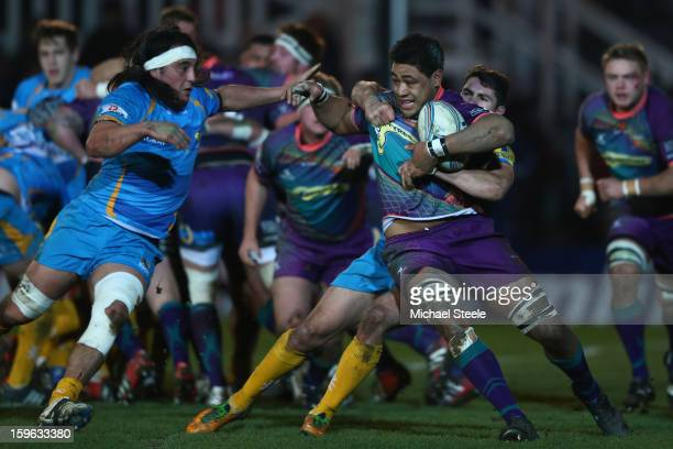 Toby Faletau of Newport Gwent Dragons is held up by Charlie Davies of London Wasps as Jonathan Poff closes in during the Amlin Challenge Cup Pool...