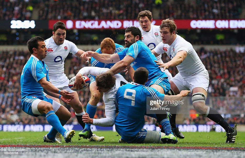 Toby Flood of England is tackled by the Edoardo Gori and Andrea Masi of Italy near the try line during the RBS Six Nations match England and Italy at Twickenham Stadium on March 10, 2013 in London, England.