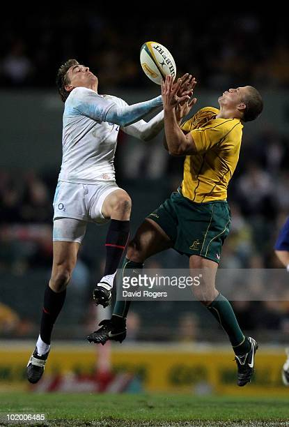 Toby Flood of England jumps for the ball against Luke Burgess during the Cook Cup Test match between the Australian Wallabies and England at the...
