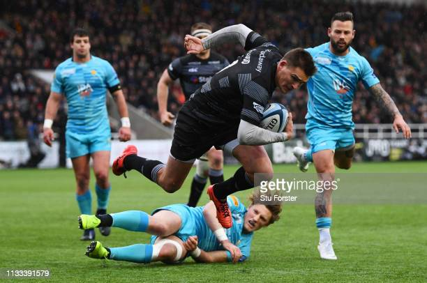Toby Flood of Newcastle Falcons crosses to score their second try during the Gallagher Premiership Rugby match between Newcastle Falcons and...