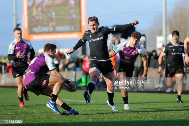 Toby Flood of Newcastle Falcons tries to flyhack the ball through during the Greene King IPA Championship match between Newcastle Falcons and Cornish...
