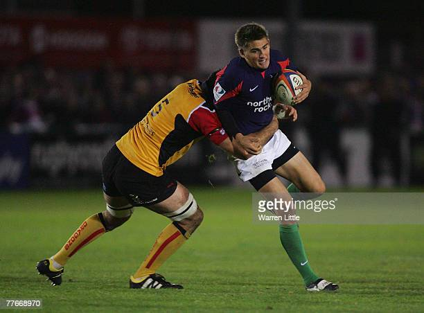 Toby Flood of Newcastle is tackled during the EDF Energy Cup match between Newcastle Falcons and Newport Gwent Dragons at Kington Park on November 3...