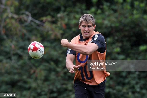 Toby Flood passes the ball during the England training session held at the Pennyhill Park Hotel on August 11 2011 in Bagshot England